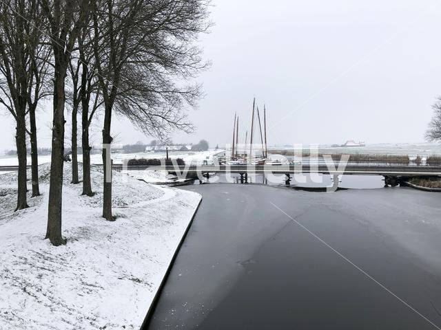Skutsjes during winter in Sloten, Friesland, The Netherlands