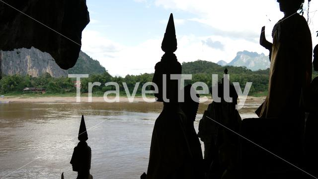 Standing Buddhas overlooking the Mekong in Pak Ou Laos