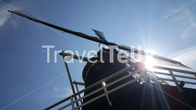 Lens flare trough windmill in Netherlands