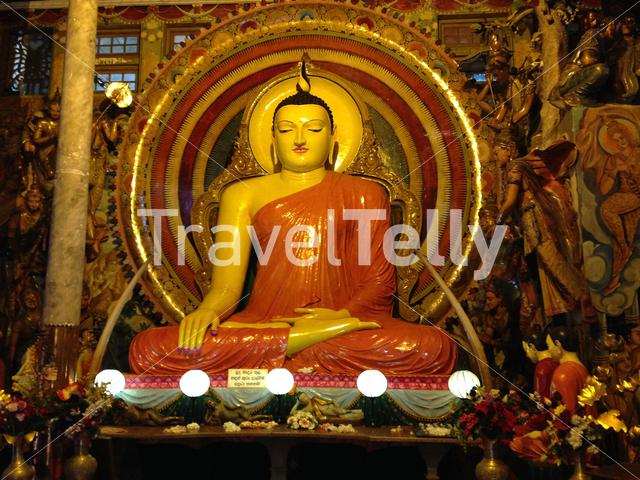 Buddha statue in the Gangaramaya Temple in Colombo Sri Lanka