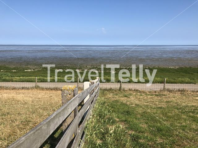 Dike and the wadden sea in Friesland, The Netherlands