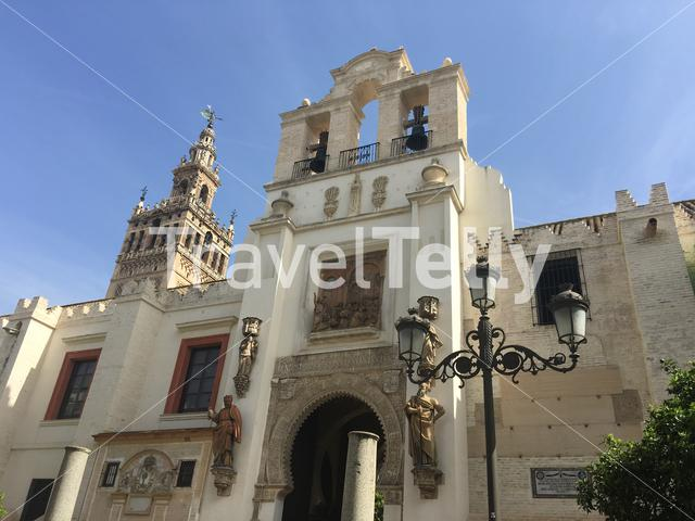 Door of Pardon and Patio de los Naranjos with the  La Giralda (Bell tower) from the Seville cathedral in Spain