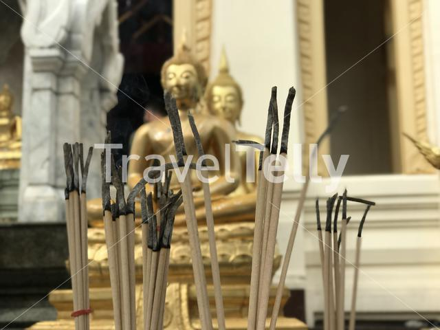 Incense in front of Golden buddha statue at the Wat Trai Mit Golden Buddha Temple in Bangkok Thailand