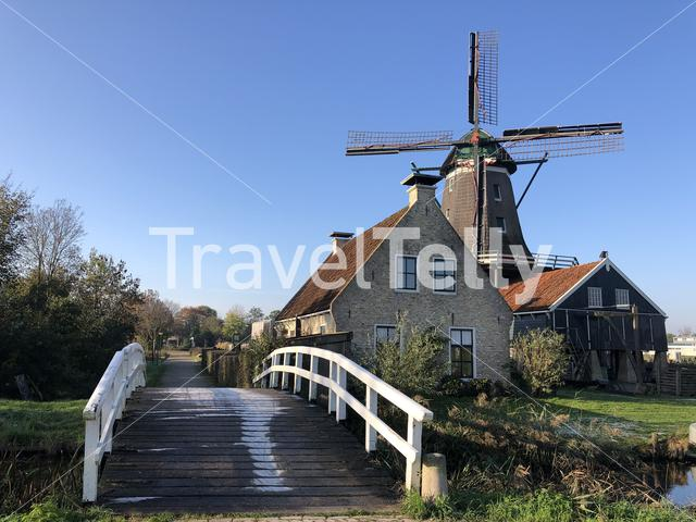 Windmill in IJlst during autumn in Friesland, The Netherlands