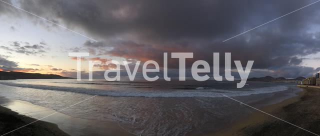 Panorama from dark clouds above Las Canteras beach during sunset in Las Palmas, Gran Canaria