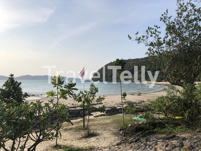 Thai flag at Ao Phrao beach on Koh Samet island in Thailand