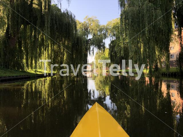 Canoeing at the canal around the old town of Sneek in Friesland The Netherlands