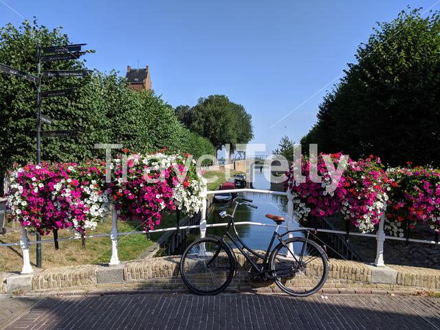 Bicycle on a canal bridge in Sloten, Friesland The Netherlands