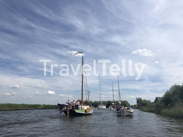 Boats on a canal near Langweer in Friesland The Netherlands