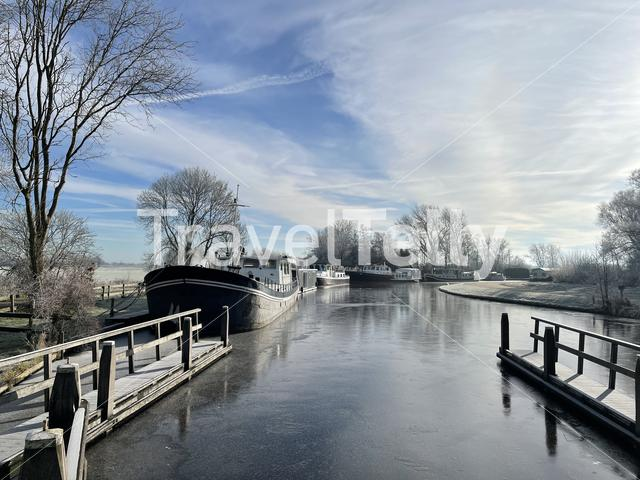 Boats during winter around Terherne in Friesland The Netherlands