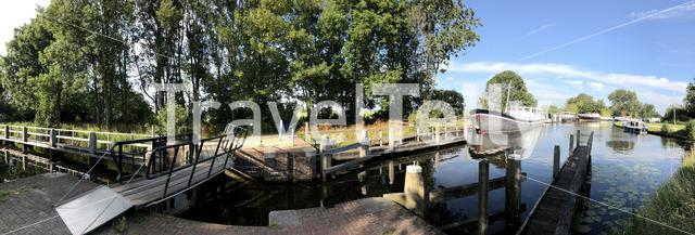 Panorama from a small canal lock around the Sneekermeer in Friesland The Netherlands