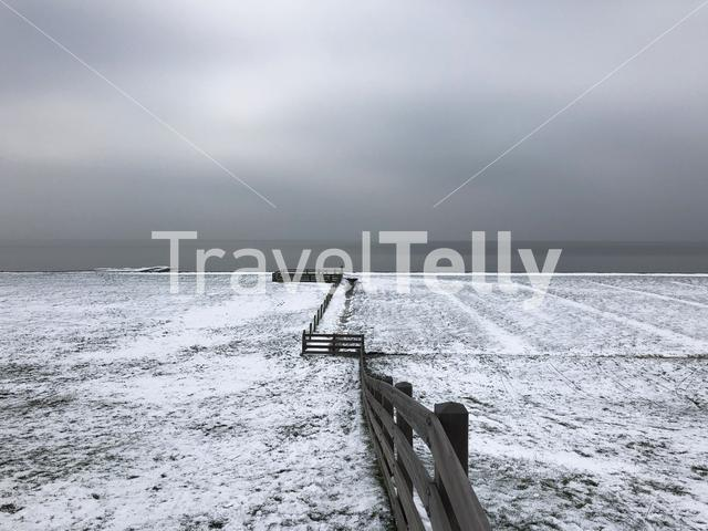 Dike with snow in Hindeloopen The Netherlands