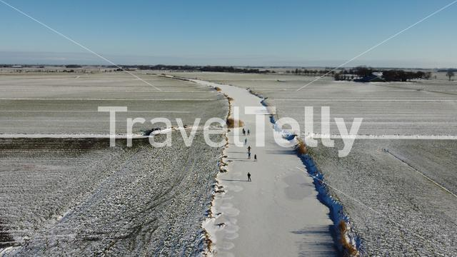 People ice skating on a frozen canal around Sneek in Friesland The Netherlands