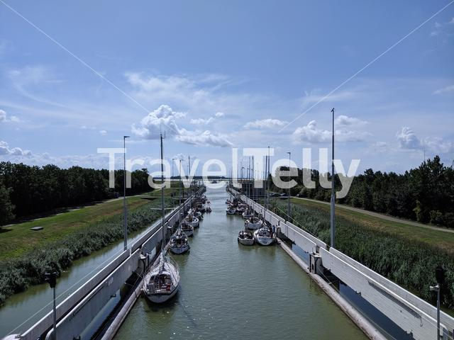Sailboat in a lake lock around Lemmer in Friesland The Netherlands