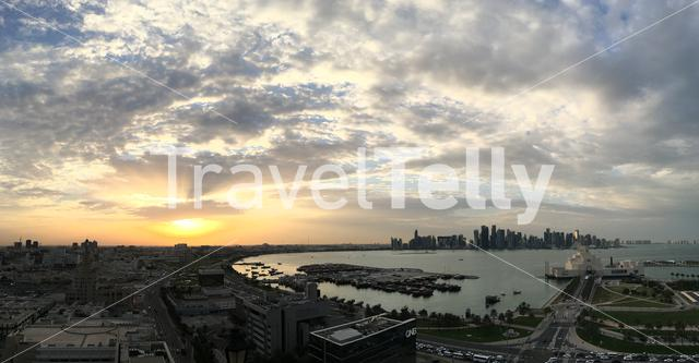 Overview of the Dhow Harbour with the Museum of Islamic Art on the Corniche during sunset in Doha Qatar
