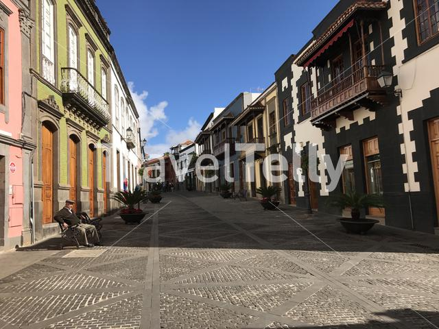 Elderly man sitting on a bench in the old town of Teror Gran Canaria