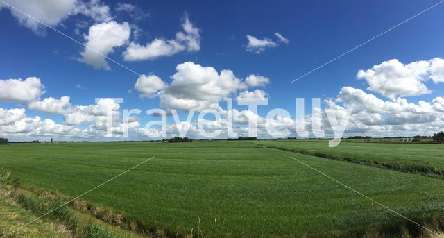 Frisian landscape panorama with clouds in The Netherlands