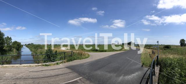 Panorama from a road though the countryside of Friesland The Netherlands