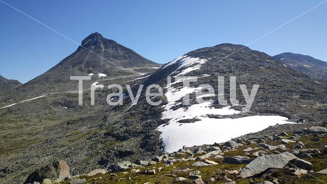 Mountains with snow in Jotunheimen National Park Norway