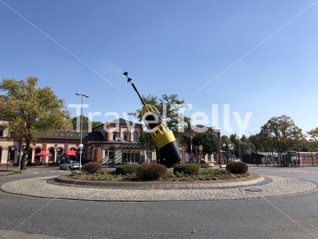 Buoy at the roundabout in front of railway station in Leer, Germany