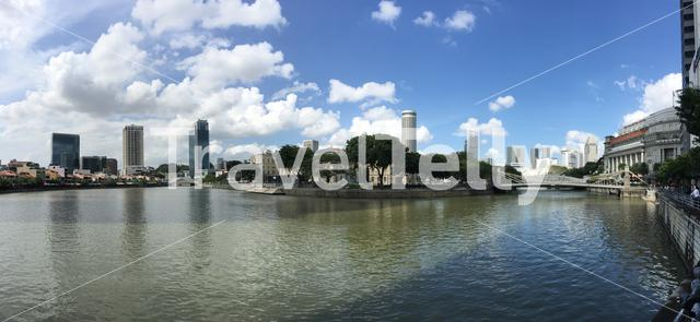 Panorama from the Singapore river with the Cavenagh Bridge