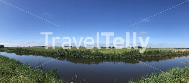 Panorama from a canal in between Bartlehiem and Aldtsjerk in Friesland, The Netherlands