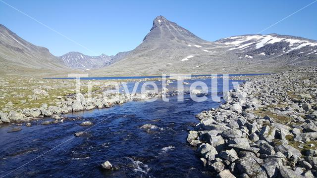 Stream in to a lake at Jotunheimen National Park Norway