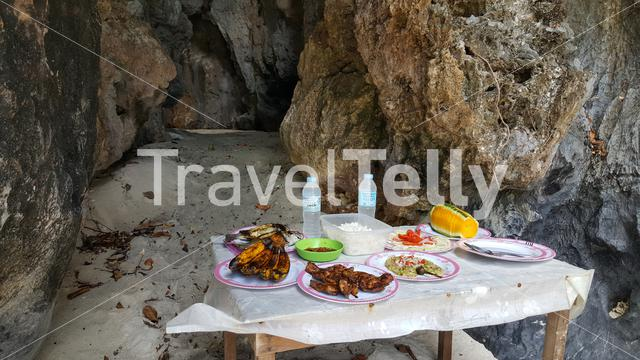 Philipino lunch in private cave on island at El Nido, Palawan