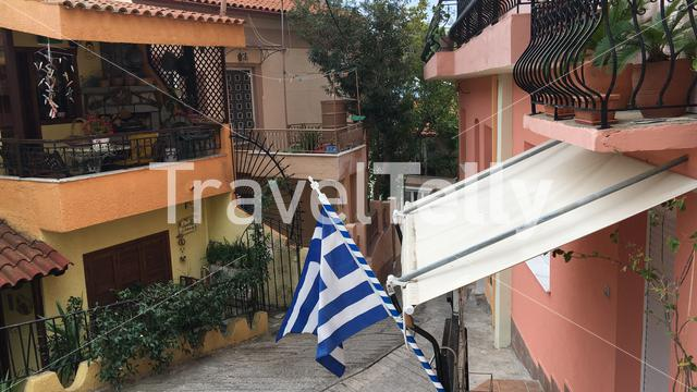 Greek flag in the old town of Kavala Greece