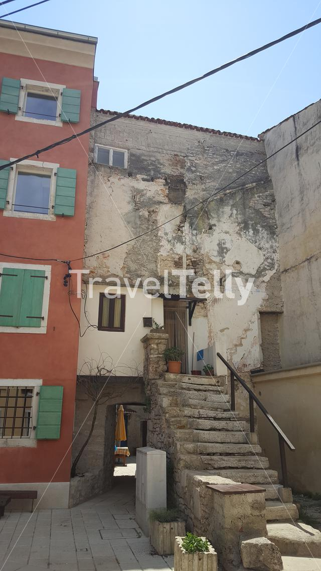 Old house in alley of old town of Fazana, Croatia