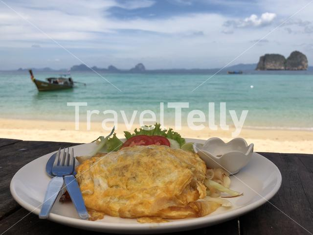 Pad Thai wrapped in egg on the beach of Koh Ngai in Thailand