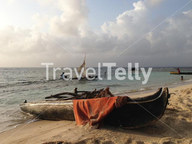 Traditional wooden canoe on he beach of the  san blas islands in Panama