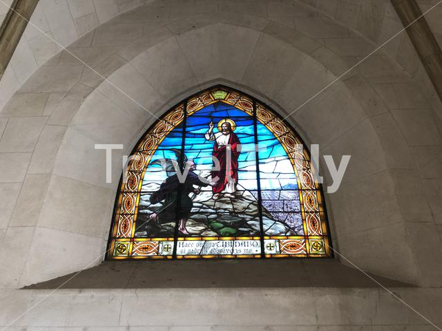 Stained glass inside the Expiatory Church of the Sacred Heart of Jesus in Barcelona, Spain