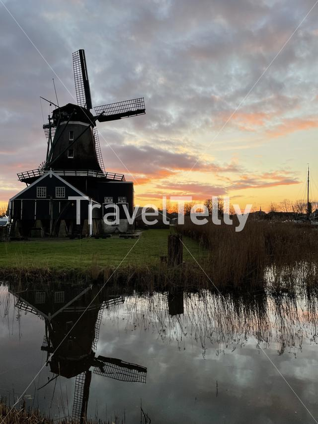 Windmill in IJlst during sunset in Friesland The Netherlands