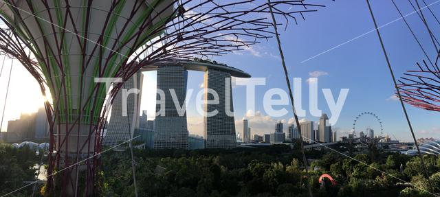 Marina Bay Sands, Singapore Flyer and Flower dome during sunset from the Supertree Grove at Gardens by the Bay in Singapore