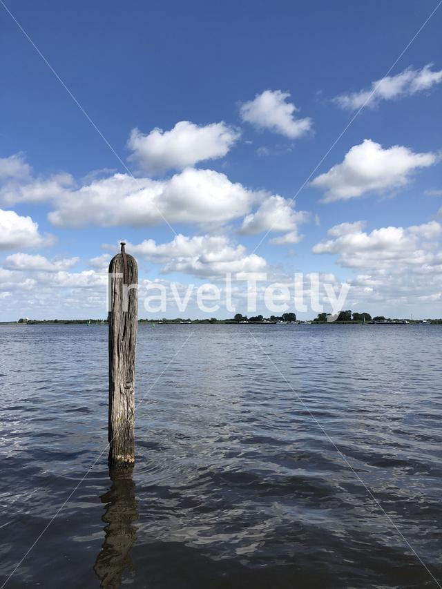Pole in a lake in Friesland The Netherlands