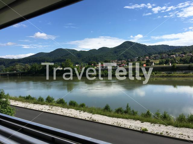 Train driving next to the Sava river In Bostanj Sjlovenia