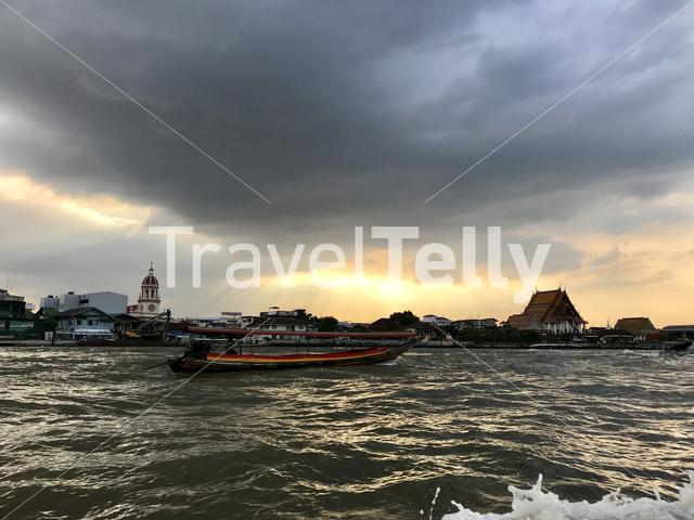 Dark clouds during sunset above the Chao Phraya River in Bangkok Thailand