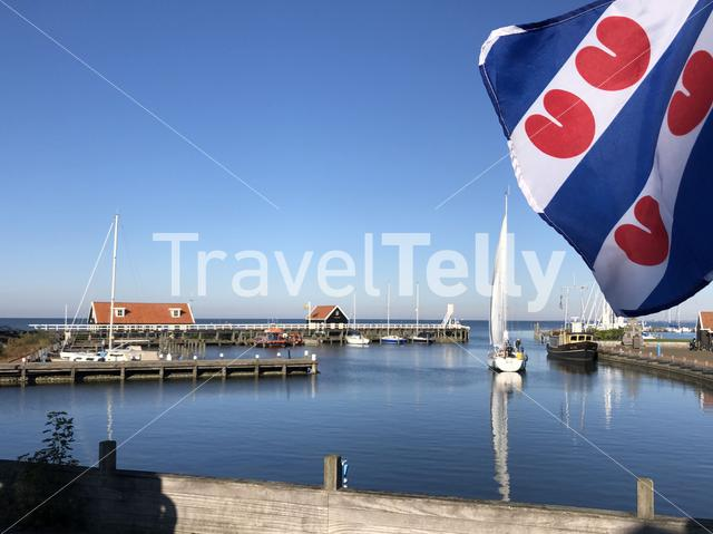 Frisian flag at the harbor in Hindeloopen during autumn in Friesland, The Netherlands