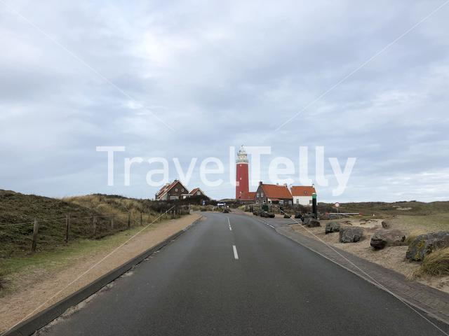 Road towards the lighthouse on Texel island in The Netherlands