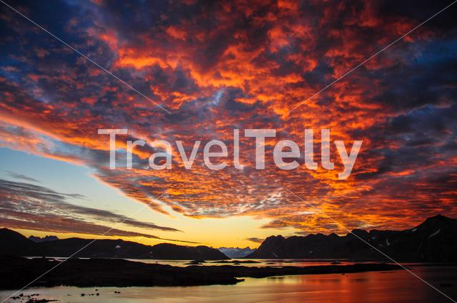 Sunset with pink clouds over Kulusuk Greenland