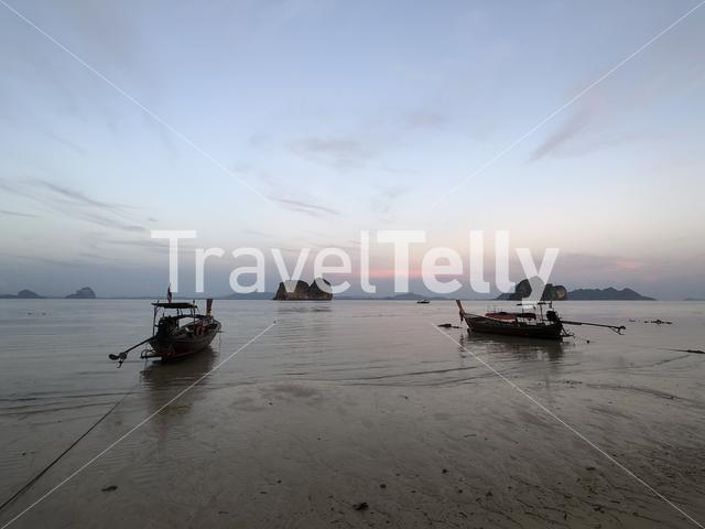 Long-tail boats during low tide on Koh Ngai island in Thailand