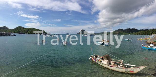 Panorama from dugout catamaran boats in the harbor of Labuan Bajo at the island Flores in Indonesia