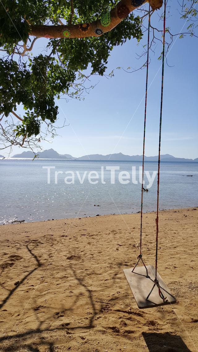 Swing at sunny beach of El Nido, Palawan, Philipinnes