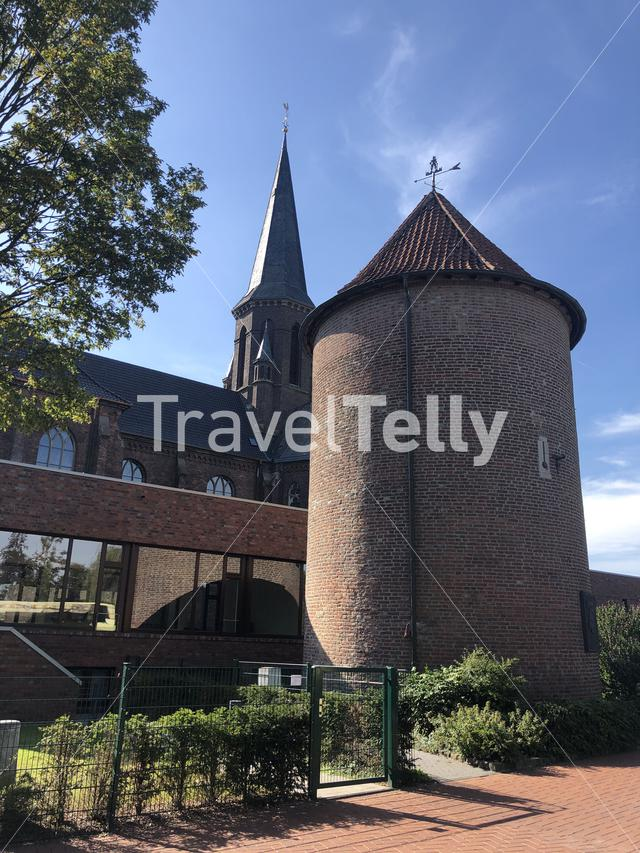 Historic city tower and the St. Bartholomäus church in Isselburg, Germany