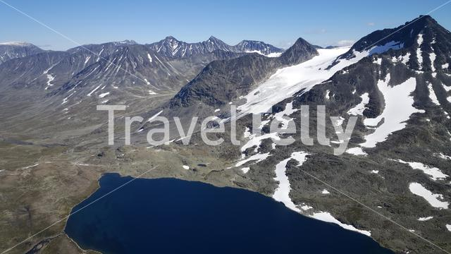 Lake and snowy mountains in Jotunheimen National Park Norway