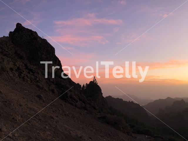 Sunset and pink sky at Roque Nublo the volcanic rock on the island of Gran Canaria