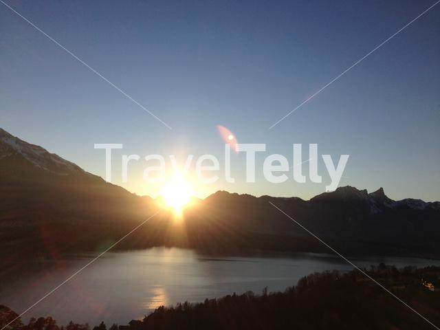 Sunset at Lake Thun seen from the town Gunten in Switzerland