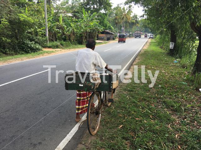 Man walking with a bicyle in Sri lanka