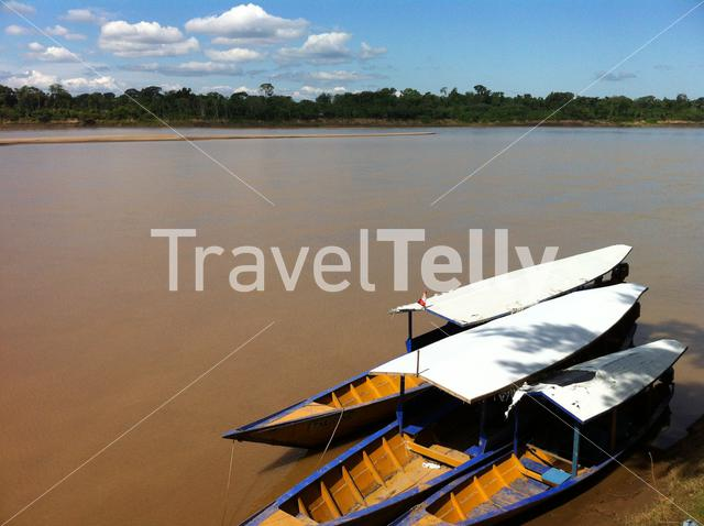 Long tail boats at the Amazon river in Peru
